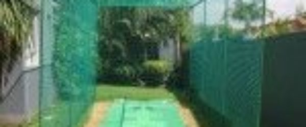 Free-standing-net-system-with-Flicx-pitch-on-grass-cricket practice nets - cricket nets for sale - cricket net price - cricket nets south africa